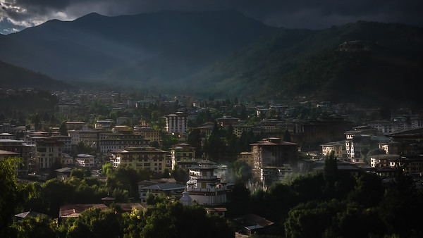 Thimpu, the capital of Bhutan.  Largest city with a population of about 100,00 in a country of about 800,000 total population.