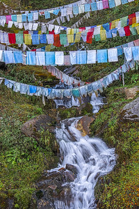 Chele La, Bhutan's highest motorable pass (12,500 ft) is home to thousands of prayer flags.  Mounting prayer flags as high as possible helps the prayers be carried by the wind to be heard by gods.