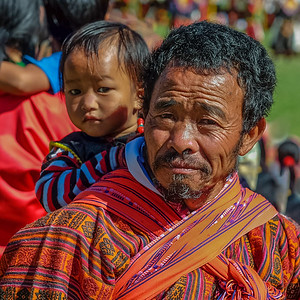 Man with Child.  Bhutan--October 2014--The People, Places, Culture