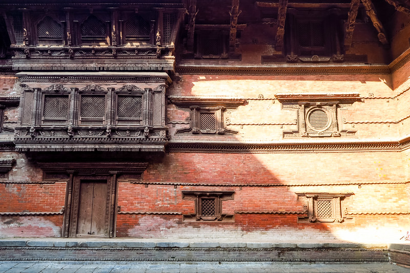Intricate wood carvings seen on the buildings in Durbar Square