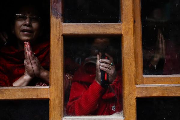 Women raise join their palms in 'namaste' at Bhaktapur Durbar Square in Kathmandu, Nepal, April 28, 2015. (Photo by Mallory Olenius)