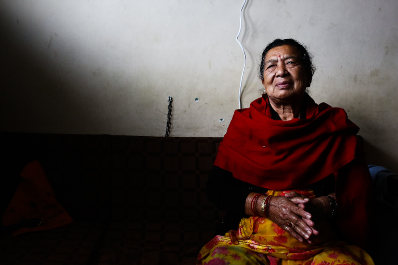 A woman sits in a hospital room in the overflowing Teaching Hospital in Kathmanda, Nepal on April 28, 2015. Her husband was admitted for a stroke twenty days prior the devastating earthquake. (Photo by Mallory Olenius)