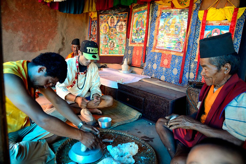 """..w hereas  at the entrance lamas make  """"tormas"""" out of rice to appease the Gods."""