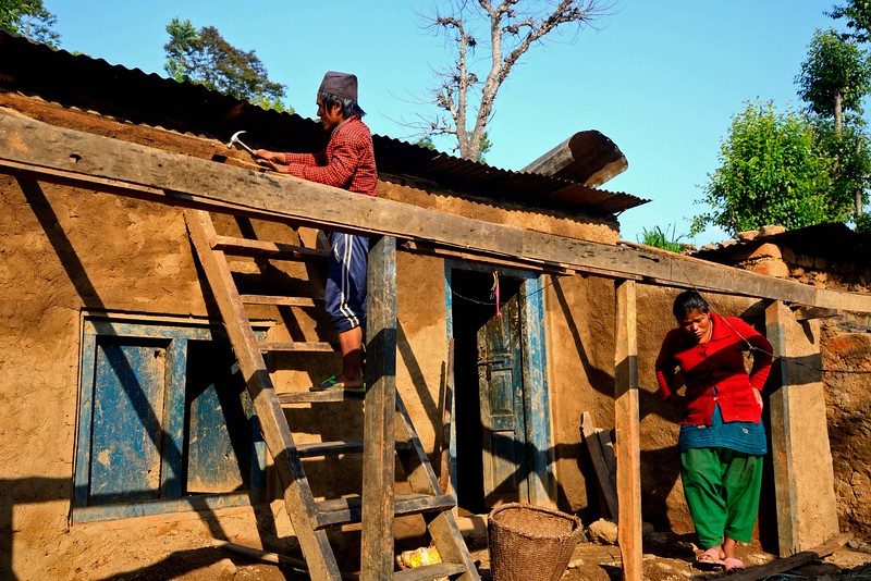 """In a display of rare courage and initiative Eskumar begins  the repairs of his  home.  I ask him what he is using and he says """" the same broken bits which had collapsed in the earthquake""""."""