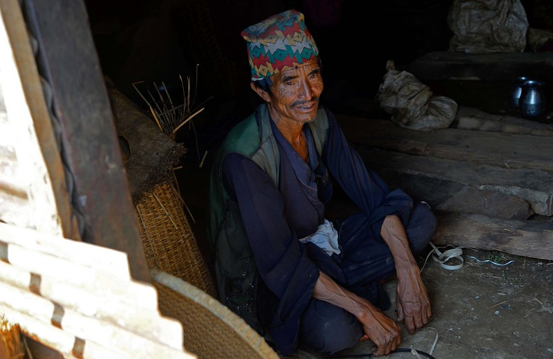 Dil Bahadur sits and waits for relief materials from the Government which may never arrive.