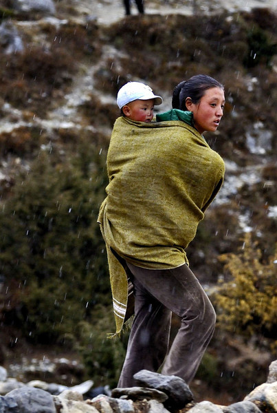 Mother and child walking in snow - Pangboche village