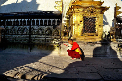 A lama circles the stupa of Swayambhunath