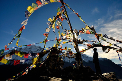 Prayer flags atop the first Kyanjin Ri view point above Kyanjin Gompa. The peak in the background is  Naya Kangri (5846m).