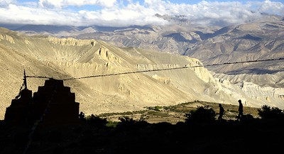 Looking out at sunset over the chortens of Ghar Gompa towards the fields of Lo Gekar and Marang
