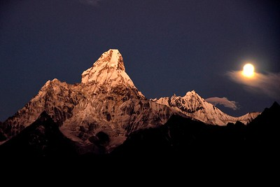 Ama Dablam seen from a ridge above the village of Khunde around 4000 metres  with the rising moon