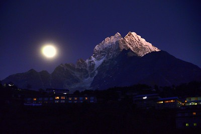 The almost full moon rising behind  Thamserku on a winter's evening from Namche Bazar