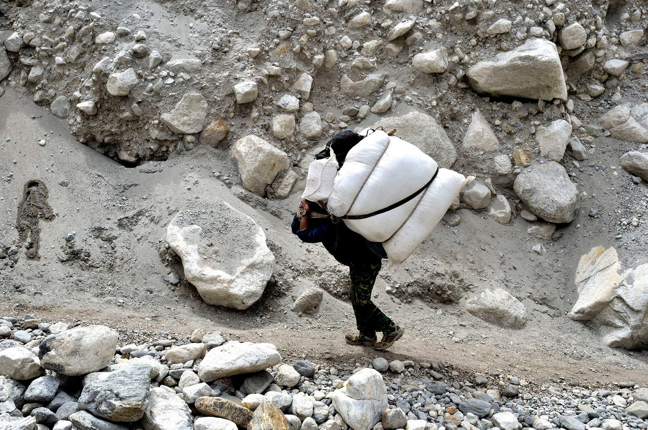 Carrying garbage from Everest Base Camp down the Khumbu glacier