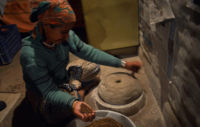 The constant workhorse (like all Nepalise women) Ama Tileu coarse grinding kodo (millet) which will be used for buffalo feed once per week.