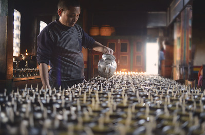 The filling of yak butter candles at Swayambhunath stupa, Kathmandu