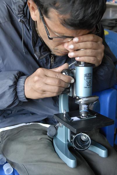 Sahadev testing a microscope.
