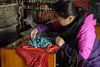 This woman had brought in turquise to trade at a small Tibetan store.