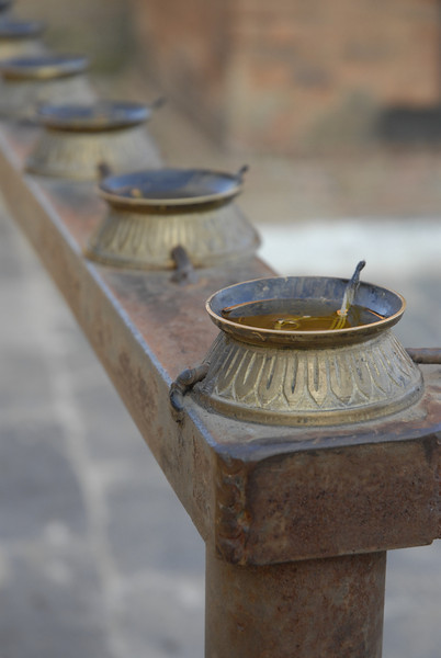 These oil/butter lamps surround the temple.