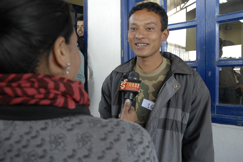 Another Rotaractor being interviewed.