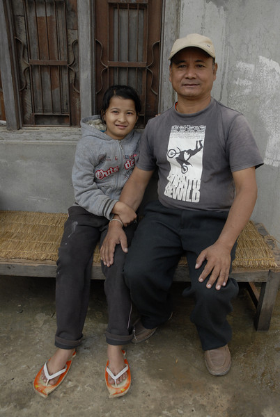 Chandra and his grandaughter.