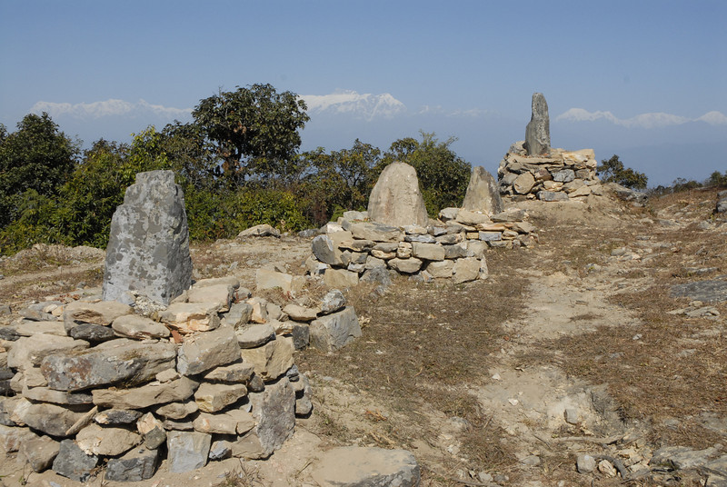 At this spot travelers have created small stupas in reverence.