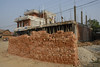 This is typical construction in Nepal. Very labor intensive.