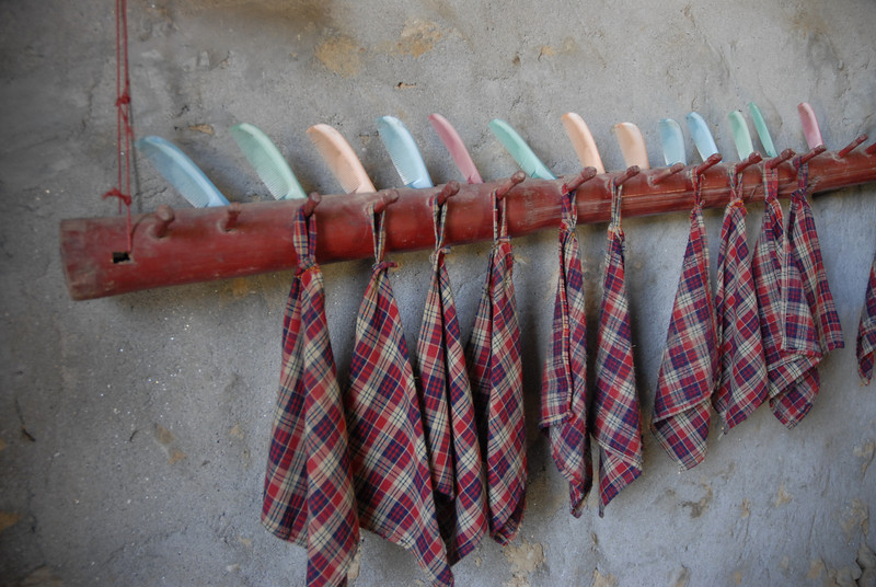 All of the pre-schools have these handkerchief racks. Runny noses are a norm here where there is no heating, water or soap is not always available for children to wash thier hands, etc.