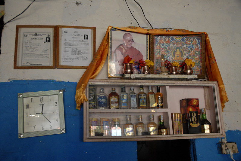Ok...another jump. I am in a small Tibeatn resturant and found this scene ironic. The Dali Lama set above the alcohol display.
