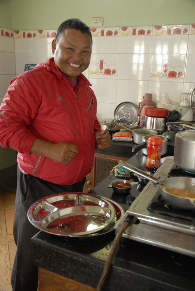 Tuna and his wife cooked lunch for us. I love his smile and happiness.