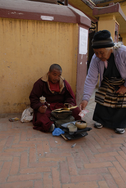 You will find monks praying and seeking alms around the site.
