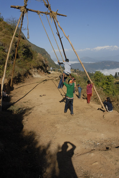 These are the typical swings in Nepal.  Usually made from bamboo poles and about 15-20 ft. high.