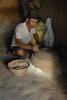 Grinding cornmeal.