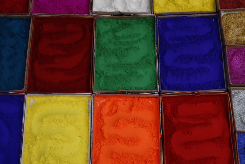 These are colored powders used for creating the mandalas that are made at the base of household and business entrances during the Tihar festival.