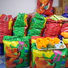 Bags of kits ready to be distributed. Your donation purchased 428 kits for girls.