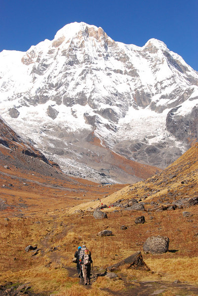 The last  hour of trail approaching South Annapurna Base Camp, which barely can be seen (blue buildings) just below the center of the photo.  Base camp sits at the foot of the northeast face of Annapurna South (7129 m; 23,684 ft).  We are now 8 days walk from the road, so not a good place to twist your ankle.