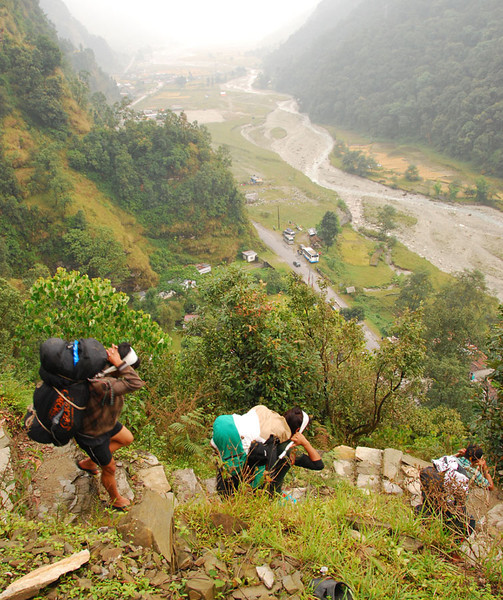This is the last section of trail:  down 1500 feet on 45 degree stone steps to the bus stop at Phedi (seen near the center).  An hour later you're in Pokara getting ready for a night on the town after 16 days on the trail.