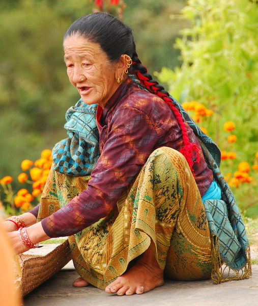 Mama Gurung, age 70, was busy shelling beans when we arrived.  She stopped work, laid out mats for us to sit on, and then showed us her home.