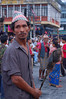 Nepal, Pokhara: Protester waits with his unlit torch.