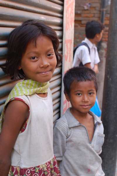Nepal, Kathmandu: Siblings in the streets of Kathmandu.