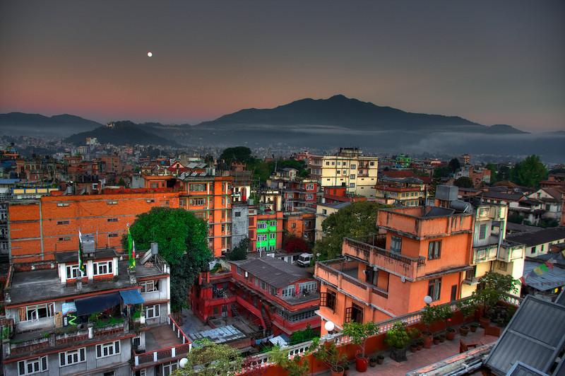 Bwong: Kathmandu at moonset/sunrise from the Tibet Guest House roof.