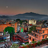 Bwong: Kathmandu at moonset/sunrise from the Tibet Guest House roof.