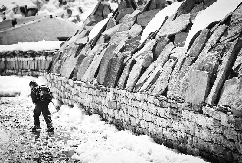 Mani wall border the Sir Edmund Hillary School in Khumjung