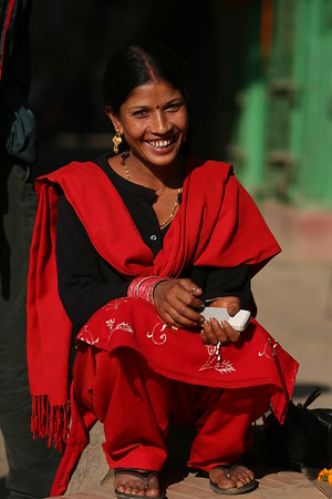 Pretty in red, this lovely lady posed for me in Patan.