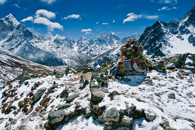 A Sherpa memorial set against a Himalayan backdrop,