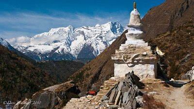 Stupas stand proud against the Himalayan Backdrop.