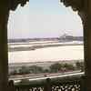 Distant view of Taj Mahal along the Yamuna river