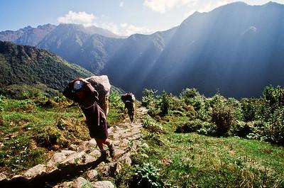 Porters ascending Deorali Danda ridge