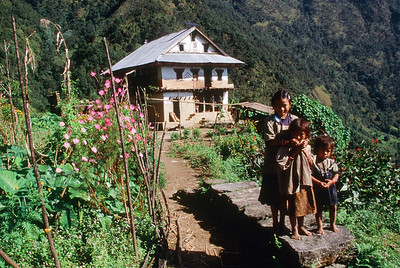 Children in front of farm house