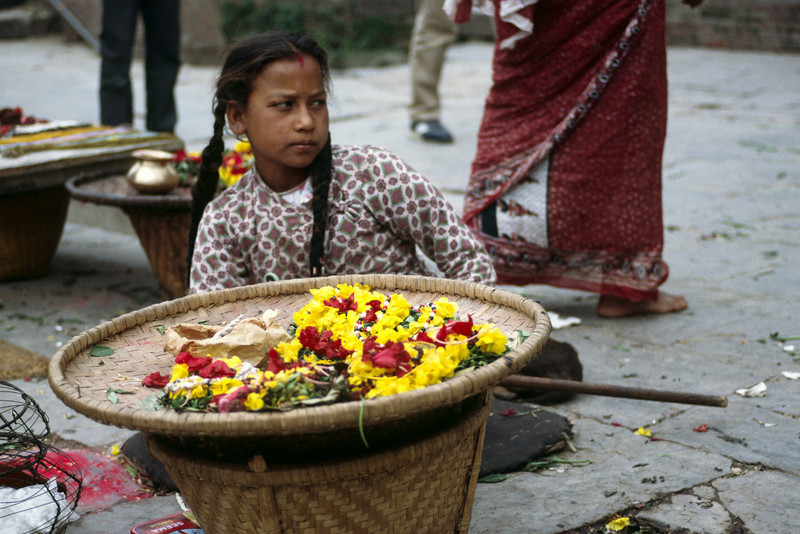 Selling flowers to go with the ashes into the holy Bagmati river