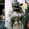 One of the sentinels at  the entrance to Seto Machhendranath - a 17th century temple to the protector god of the Kathmandu Valley. The god is known to the Newars as Karunamaya Lokeshwar, the bodhisattva of compassion. The Tibetans consider him Jowo Dzamling Karmo - White Lord of the World.<br /> <br /> The following images are from around the outside of the temple.