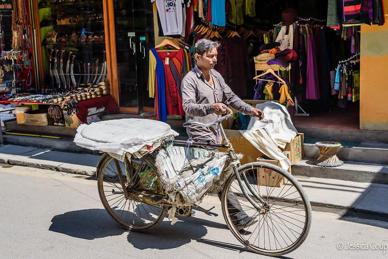 Walking His Bike